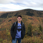 Photograph of Devon Parfait in early fall in front of Mount Greylock